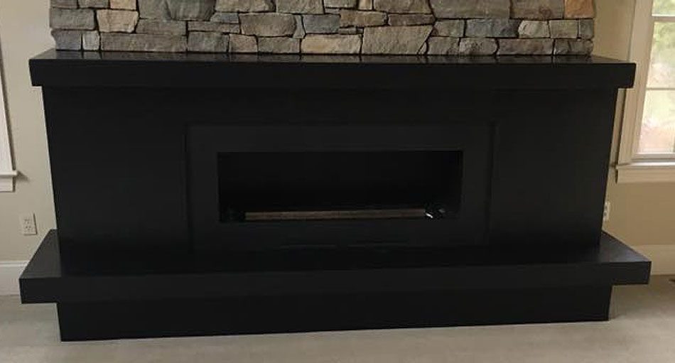 Granite Works, LLC custom granite fireplace hearth and mantel